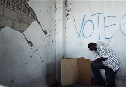 A Haitian man marks his presidential ballot during elections in Port-au-Prince March 20, 2011. REUTERS/Eduardo Munoz