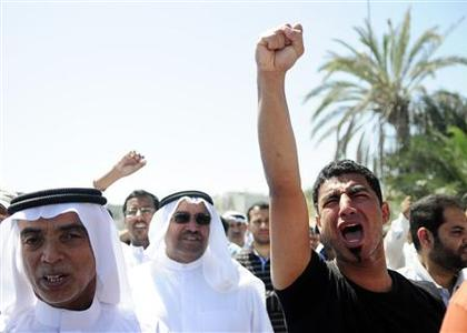 A man shouts anti-government slogans during the funeral of Isa Abdul Ali Radhi in Sitra March 20, 2011. Isa, 47, died of wounds sustained in clashes with security forces in Sitra on Wednesday. REUTERS/James Lawler Duggan