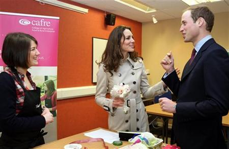 Prince William and his fiancee, Kate Middleton, laugh as the speak to wedding florist Rachel Gibson (L), during a visit to the Greenmount Agriculture & Food College, in Antrim, Northern Ireland March 8, 2011. Those who want to keep up with the latest news about next month's royal wedding, polish up their palace protocol or pass on marriage advice to the royal couple can now buy a ''one-stop wedding shop'' iPad application. REUTERS/Paul Faith/Pool