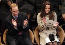 <p>Britain's Prince William and his fiancee, Kate Middleton, applaud as they watch a play at the Youth Action Northern Ireland Centre, in Belfast, Northern Ireland March 8, 2011. REUTERS/Phil Noble</p>