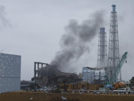Smoke is seen coming from the area of the No. 3 reactor of the Fukushima Daiichi nuclear power plant in Tomioka, Fukushima Prefecture in northeastern Japan, March 21, 2011. REUTERS/Tokyo Electric Power Co.