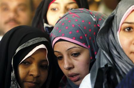 Women wait outside a polling center at a school during a national referendum in Cairo, March 19, 2011. REUTERS/Amr Abdallah Dalsh