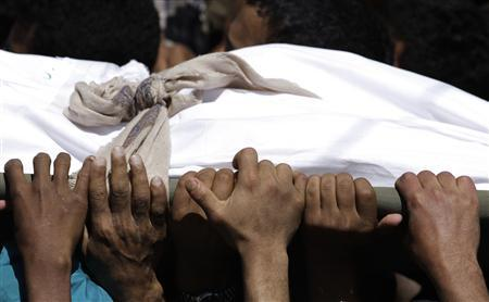 Mourners carry the body of an anti-government protester during a funeral in Sanaa March 22, 2011. REUTERS/Khaled Abdullah