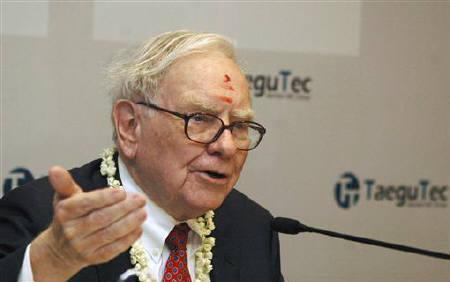 Billionaire Warren Buffett, wearing a traditional tikka or a red mark on the forehead, speaks during a news conference in Bangalore March 22, 2011. REUTERS/Stringer