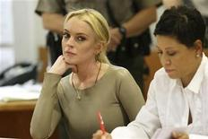 <p>Actress Lindsay Lohan (L), with her attorney Shawn Chapman Holley, appears in Airport Courthouse in Los Angeles March 10, 2011. REUTERS/David McNew/Pool</p>