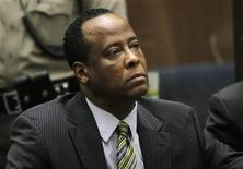 <p>Doctor Conrad Murray, the late Michael Jackson's personal physician, listens during his arraignment on a charge of involuntary manslaughter in the pop star's death, in Los Angeles, California, January 25, 2011. REUTERS/Irfan Khan/Pool</p>