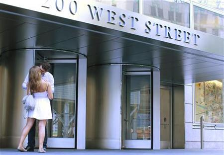 A man and woman embrace outside the Goldman Sachs Group Inc. global headquarters, also known by its address as 200 West Street, in New York's lower Manhattan, July 15, 2010. REUTERS/Brendan McDermid