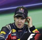 <p>O campeão mundial Sebastian Vettel, da Red Bull, mostrou por que é favorito ao título ao conquistar a pole postion do Grande Prêmio da Austrália, prova de abertura da temporada 2011 da Fórmula 1. REUTERS/Daniel Munoz</p>