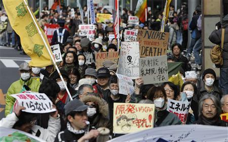 Protesters take part in an anti-nuclear rally in Tokyo March 27, 2011. REUTERS/Toru Hanai