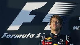 <p>Um Sebastian Vettel tímido se mostrou determinado a não se deixar empolgar com a espantosa largada na defesa de seu título mundial no Grande Prêmio da Austrália deste domingo. REUTERS/Daniel Munoz</p>