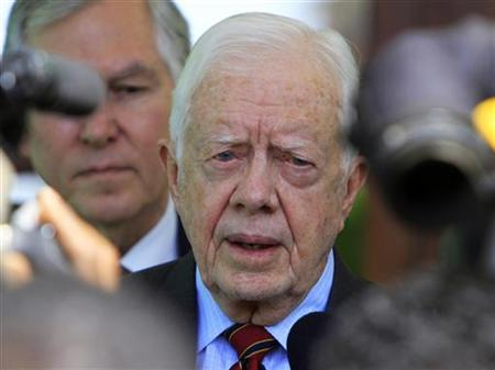 Former U.S. President Jimmy Carter, who is in Sudan as a referendum observer, talks to the media after meeting Sudan's President Omar Hassan al-Bashir in Khartoum January 8, 2011. REUTERS/Mohamed Nureldin Abdallah
