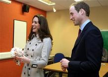<p>Britain's Prince William and his fiancee, Kate Middleton, speak to a wedding florist, during a visit to the Greenmount Agriculture & Food College, in Antrim, Northern Ireland March 8, 2011. REUTERS/Paul Faith/Pool</p>