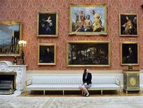<p>Jennifer Scott, Assistant Curator of Paintings, sits in the Picture Gallery, which will be used during the wedding reception of Prince William and Kate Middleton, at Buckingham Palace, March 25, 2011. REUTERS/Nick Ansell/POOL</p>