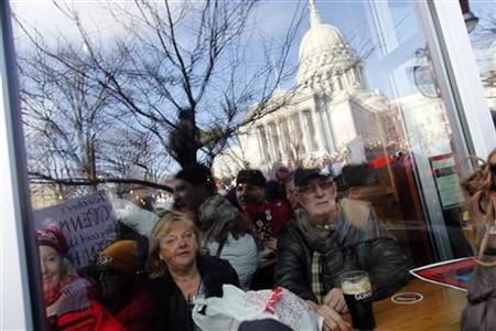 Massive crowds gather to see the 14 democratic senators that left the state to protest the bill proposed by the Gov. Scott Walker at the Wisconsin State Capitol in Madison, March 12, 2011. REUTERS/Darren Hauck