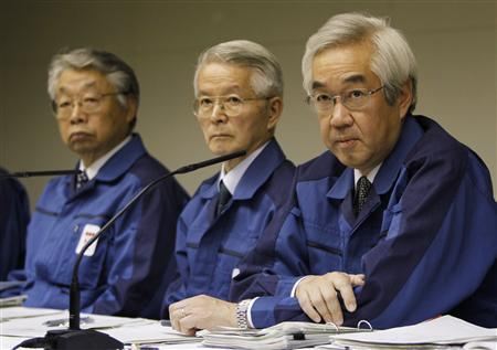 Tokyo Electric Power Company, Inc. (TEPCO) Chairman Tsunehisa Katsumata (C) and Executive Vice-Presidents Sakae Muto (R) and Takashi Fujimoto attend a news conference at the company's head office in Tokyo March 30, 2011. Tokyo Electric Power has secured $24 billion in bank loans but said it would not be enough to keep the company running, adding to fears the utility may collapse under the strain of paying for Japan's worst nuclear disaster. REUTERS/Toru Hanai