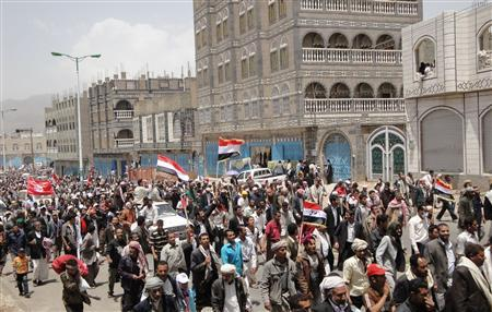 Anti-government protesters march in the central Yemeni city of Ibb to demand for the ouster of President Ali Abdullah Saleh, March 30, 2011. REUTERS/Stringer