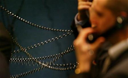 Telephone cables get tangled as brokers take telephone bids during trading on the floor of the London Metal Exchange in London in this January 7, 2004 file photo. REUTERS/Russell Boyce