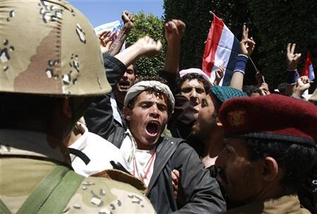 Public school teachers demanding pay rise shout slogans after army soldiers blocked them during a demonstration in Sanaa April 3, 2011. Two Yemenis died and hundreds were hurt on Sunday when police used live rounds, tear gas and batons to try to break up protests against Saleh, who called for an end to weeks of unrest. REUTERS/Khaled Abdullah (YEMEN - Tags: POLITICS CIVIL UNREST MILITARY EDUCATION EMPLOYMENT BUSINESS)