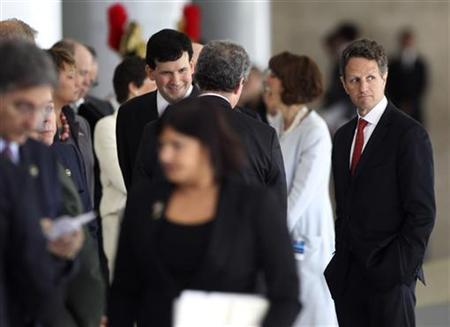 Treasury Secretary Timothy Geithner and other members of President Barack Obama's cabinet wait to be introduced to Brazil's President Dilma Rousseff at the Planalto Palace in Brasilia, March 19, 2011. REUTERS/Jason Reed