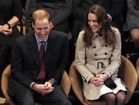 Britain's Prince William and his fiancee, Kate Middleton, watch a play at the Youth Action Northern Ireland Centre, in Belfast, Northern Ireland March 8, 2011. REUTERS/Phil Noble