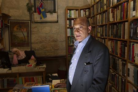 Palestinian book shop owner Munther Fahmi poses for a photograph in his shop in east Jerusalem April 3, 2011. REUTERS/Ronen Zvulun