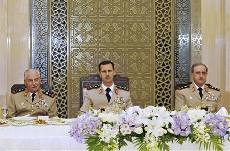 Syria's President Bashar al-Assad (C) attends a dinner in honor of the army officers on the 65th Army Foundation anniversary in Damascus August 1, 2010. On left is Syrian Defense Minister General Ali Habib and on right, Chief of Staff General Dawoud Rajha. REUTERS/Sana