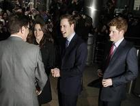 <p>Britain's Prince William (2nd R), his fiancee Kate Middleton and brother Harry (R) speak with New Zealand's High Commissioner in London Derek Leask as they leave after signing a book of condolence for the victims of the earthquake at the New Zealand High Commission in London February 25, 2011. REUTERS/Luke MacGregor</p>