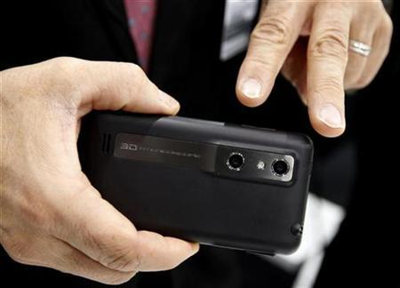 A man displayed the LG Optimus 3D, the company's new smartphone with a dual-lens camera function, during the GSMA Mobile World Congress in Barcelona February 17, 2011. REUTERS/Gustau Nacarino
