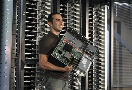 Amir Michael, hardware design manager at Facebook, holds an ''open compute program'' server from the racks at Facebook's headquarters in Palo Alto, California April 7, 2011. REUTERS/Norbert von der Groeben