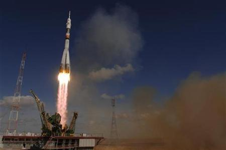 The Soyuz TMA-13 spacecraft, carrying Expedition 18 Commander Michael Fincke, Flight Engineer Yury V. Lonchakov and video game magnate Richard Garriott, lifts off from the Baikonur Cosmodrome in Kazakhstan October 12, 2008. EUTERS/NASA/Bill Ingalls/Handout