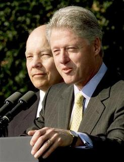 President Bill Clinton makes an announcement as John Koskinen, Chairman of the President's Council on Year 2000 Conversion, stands by his side on the South Lawn of the White House in this November 10, 1999 file photo. REUTERS/Win McNamee