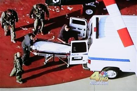 The body of Michael Jackson is loaded into a van to be taken to the Los Angeles County Coroner's office, June 25, 2009. REUTERS/KNBC4/Handout