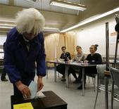 <p>Iceland's Prime Minister Johanna Sigurdardottir (L) casts her vote in the Icesave referendum in Reykjavik April 9, 2011. REUTERS/Ingolfur Juliusson</p>