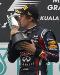 <p>Sebastian Vettel da Alemanha comemora o 1o lugar no Grande Prêmio da Malásia, sua segunda vitória de ponta a ponta em duas corridas disputadas na temporada 2011 da Fórmula 1. 10/04/2011 REUTERS/Bazuki Muhammad</p>