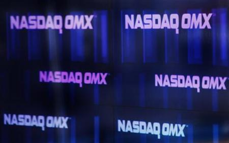 Nasdaq OMX signs are seen inside their studios at Times Square in New York April 1, 2011. REUTERS/Shannon Stapleton
