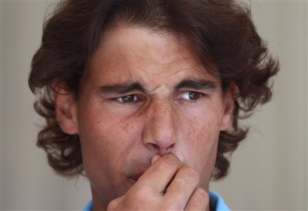 Rafael Nadal of Spain attends a news conference at the Monte Carlo Masters tennis tournament in Monaco April 11, 2011. REUTERS/Eric Gaillard