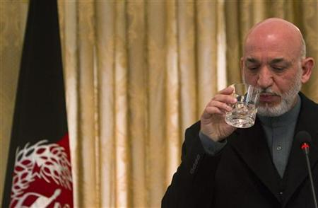 Afghan President Hamid Karzai drinks water during a news conference in Kabul, February 8, 2011. REUTERS/Ahmad Masood