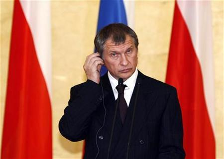 In this file photo Russia's Deputy Prime Minister Igor Sechin adjusts his earphone during a news conference following a signing ceremony in Warsaw October 29, 2010. REUTERS/Kacper Pempel