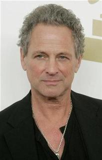 Lindsey Buckingham, a member of the group Fleetwood Mac,poses as he arrives at ''The Grammy Nominations Concert Live!: Countdown to Music's Biggest Night'' in Los Angeles, California December 3, 2008. REUTERS/Fred Prouser