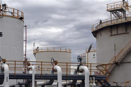 Fuel storage tanks are seen at Mobil Oil's oil refinery in Melbourne March 8, 2011. REUTERS/Mick Tsikas