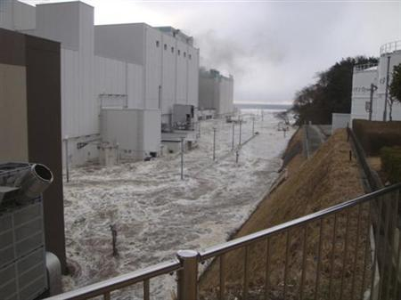 Water is seen rushing into the compound of the Fukushima Dai-ni nuclear power plant after a tsunami was triggered by the March 11, 2011 earthquake in Fukushima prefecture, northern Japan, in this handout photo released by Tokyo Electric Power Co. to Reuters on April 10, 2011. Mandatory Credit. REUTERS/Tokyo Electric Power Co/Handout