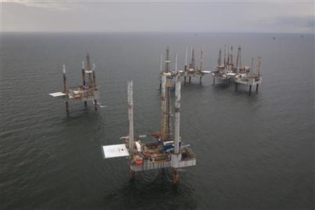 Unused oil rigs sit in the Gulf of Mexico near Port Fourchon, Louisiana August 11, 2010. REUTERS/Lee Celano