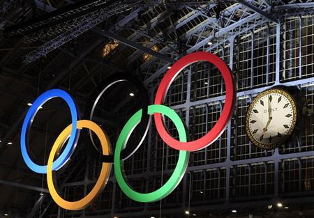 The Olympic Rings, the symbol of the Olympic Games, are illuminated at St Pancras international station in London March 3, 2011. REUTERS/Eddie Keogh