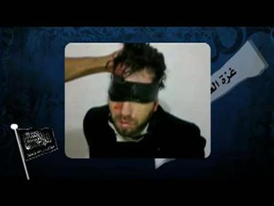 A still image taken from a YouTube video on April 14, 2011, purportedly shows blindfolded Italian Vittorio Arrigoni. REUTERS/YouTube