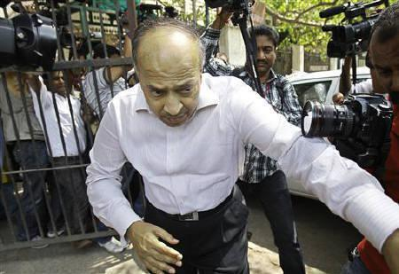 Gautam Doshi, a group managing director of Reliance ADA group, leaves a court in New Delhi April 13, 2011. REUTERS/Adnan Abidi