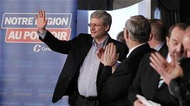 <p>Canada's Prime Minister and Conservative leader Stephen Harper waves to the crowd during a supporters rally while he campaigns at the Val-des-Neiges hotel in Beaupre, Quebec, April 14, 2011. REUTERS/Mathieu Belanger</p>