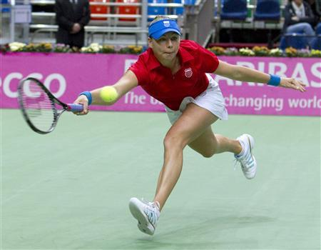 Russia's Vera Zvonareva hits a return to Italy's Roberta Vinci during their Fed Cup World Group tennis match at Sports Palace Megasport in Moscow, April 17, 2011. REUTERS/Sergei Remezov