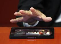 <p>Research in Motion co-CEO Jim Balsillie discusses the new BlackBerry PlayBook device during an interview with Reuters in New York September 24, 2010. REUTERS/Lucas Jackson</p>
