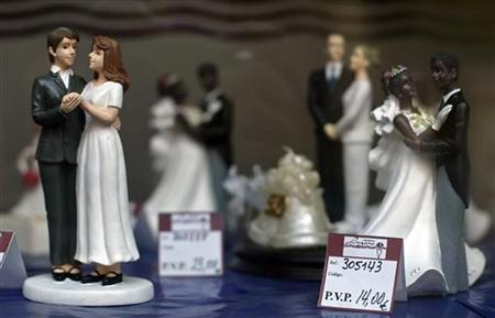 A wedding cake figurine of a couple made up of two women (L) is seen at a pastry shop in the northern Spanish town of Santander July 22, 2005. REUTERS/ Victor Fraile