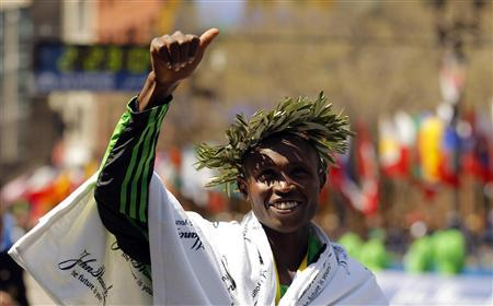 Geoffrey Mutai of Kenya gives a thumbs up after winning the men's division of the 2011 Boston Marathon in a time of 2:03:02, the fastest marathon time ever, in Boston, Massachusetts April 18, 2011. REUTERS/Brian Snyder